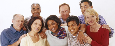 Group of diverse adults with their arms around each other, smiling
