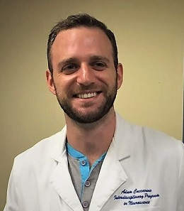 Headshot of medical student Adam Caccavano wearing a white lab coat
